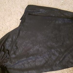 Leather look or wet look leggings